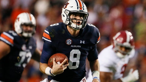 Nov 25, 2017; Auburn, AL, USA; Auburn Tigers quarterback Jarrett Stidham (8) runs the ball during the third quarter against the Alabama Crimson Tide at Jordan-Hare Stadium. Mandatory Credit: John Reed-USA TODAY Sports