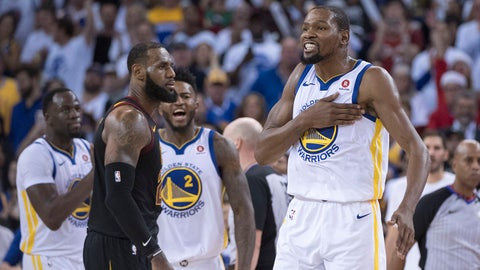 December 25, 2017; Oakland, CA, USA; Golden State Warriors forward Kevin Durant (35) celebrates in front of Cleveland Cavaliers forward LeBron James (23) during the fourth quarter at Oracle Arena. The Warriors defeated the Cavaliers 99-92. Mandatory Credit: Kyle Terada-USA TODAY Sports
