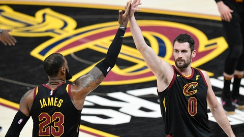 Dec 21, 2017; Cleveland, OH, USA; Cleveland Cavaliers forward LeBron James (23) and forward Kevin Love (0) celebrate in the fourth quarter against the Chicago Bulls at Quicken Loans Arena. Mandatory Credit: David Richard-USA TODAY Sports