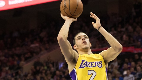 Dec 7, 2017; Philadelphia, PA, USA; Los Angeles Lakers guard Lonzo Ball (2) shoots past Philadelphia 76ers guard T.J. McConnell (12) during the third quarter at Wells Fargo Center. Mandatory Credit: Bill Streicher-USA TODAY Sports