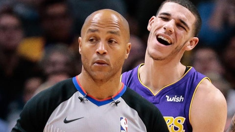 Dec 2, 2017; Denver, CO, USA; Los Angeles Lakers guard Lonzo Ball (2) reacts after being called for a foul as referee Marc Davis (8) and forward Kyle Kuzma (0) walk up court in the fourth quarter against the Denver Nuggets at the Pepsi Center. Mandatory Credit: Isaiah J. Downing-USA TODAY Sports
