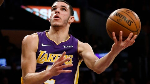 Los Angeles Lakers guard Lonzo Ball, right, looks for a shot as Golden State Warriors forward Draymond Green defends during the first half of an NBA basketball game Wednesday, Nov. 29, 2017, in Los Angeles. (AP Photo/Ringo H.W. Chiu)