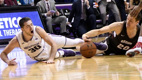 Dec 30, 2017; Rosemont, IL, USA; Northwestern Wildcats guard Bryant McIntosh (30) and Brown Bears guard Zach Hunsaker (20) go for a loose ball during the second half at Allstate Arena. Mandatory Credit: David Banks-USA TODAY Sports