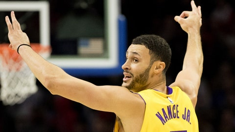 Dec 7, 2017; Philadelphia, PA, USA; Los Angeles Lakers forward Larry Nance Jr. (7) reacts to a three point shot against the Philadelphia 76ers during the fourth quarter at Wells Fargo Center. Mandatory Credit: Bill Streicher-USA TODAY Sports