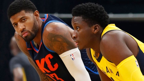 Dec 13, 2017; Indianapolis, IN, USA; Oklahoma City Thunder forward Paul George (13) and Indiana Pacers guard Victor Oladipo (4) look on from the court prior to the opening tip-off at Bankers Life Fieldhouse. Mandatory Credit: Brian Spurlock-USA TODAY Sports