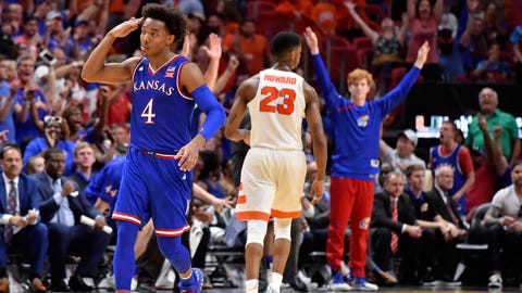 Dec 2, 2017; Miami, FL, USA; Kansas Jayhawks guard Devonte' Graham (4) reacts after making a three pointer against the Syracuse Orange during the second half at American Airlines Arena. Mandatory Credit: Steve Mitchell-USA TODAY Sports