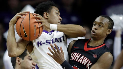 Kansas State guard Kamau Stokes, left, is covered by Southeast Missouri State guard Jonathan Dalton, right, during the first half of an NCAA college basketball game in Manhattan, Kan., Saturday, Dec. 16, 2017. (AP Photo/Orlin Wagner)