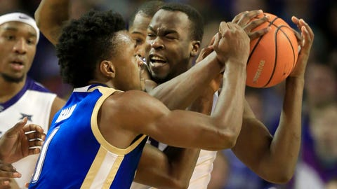 Kansas State forward Makol Mawien, back, rebounds against Tulsa forward Martins Igbanu (1) during the second half of an NCAA college basketball game in Wichita, Kan., Saturday, Dec. 9, 2017. (AP Photo/Orlin Wagner)