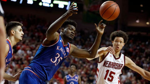 Dec 16, 2017; Lincoln, NE, USA; Nebraska Cornhuskers forward Isaiah Roby (15) and Kansas Jayhawks center Udoka Azubuike (35) fight for the rebound in the first half at Pinnacle Bank Arena. Kansas won 73-72. Mandatory Credit: Bruce Thorson-USA TODAY Sports