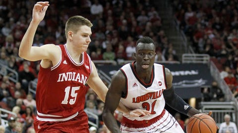 Dec 9, 2017; Louisville, KY, USA; Louisville Cardinals forward Deng Adel (22) dribbles the ball against Indiana Hoosiers guard Zach McRoberts (15) in the second half at KFC Yum! Center. Mandatory Credit: Mark Zerof-USA TODAY Sports