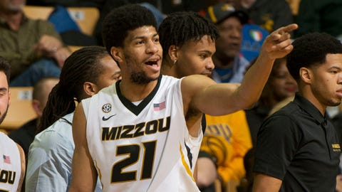 Missouri 's Jordan Barnett celebrates with teammates late during the second half of an NCAA college basketball game against North Florida, Saturday, Dec. 16, 2017, in Columbia, Mo. Missouri won the game 85-51. (AP Photo/L.G. Patterson)