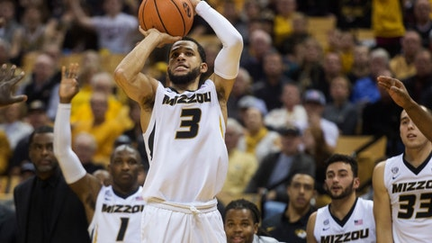 Missouri's Kassius Robertson shoots a three-point shot in front of the Missouri bench during the second half of an NCAA college basketball game against Stephen F. Austin Tuesday, Dec. 19, 2017, in Columbia, Mo. Missouri won the game 82-81. (AP Photo/L.G. Patterson)