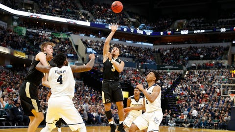 Dec 16, 2017; Indianapolis, IN, USA; Purdue Boilermakers guard Carsen Edwards (3) takes a shot against Butler Bulldogs guard Aaron Thompson (5) during the second half at Bankers Life Fieldhouse. Mandatory Credit: Brian Spurlock-USA TODAY Sports