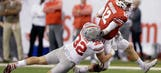 No. 4 Badgers' playoff dreams dashed after 27-21 loss to Ohio State