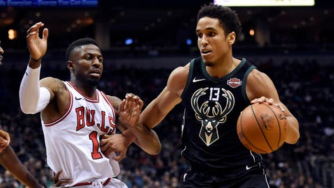 Mirotic scores 24 points off bench, Bulls beat Bucks 115-106