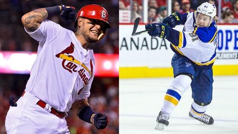 Cardinals catcher Yadier Molina and Blues forward Vladimir Tarasenko