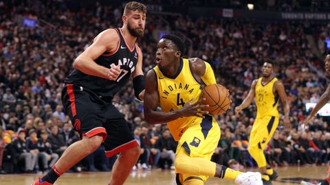 Dec 1, 2017; Toronto, Ontario, CAN; Indiana Pacers guard Victor Oladipo (4) goes to the basket against Toronto Raptors center Jonas Valanciunas (17) at Air Canada Centre. Mandatory Credit: Tom Szczerbowski-USA TODAY Sports
