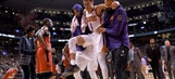 Booker carried off late in Suns loss to Raptors