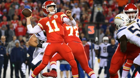 Dec 16, 2017; Kansas City, MO, USA; Kansas City Chiefs quarterback Alex Smith (11) throws a touchdown pass against the Los Angeles Chargers in the first half at Arrowhead Stadium. Mandatory Credit: Jay Biggerstaff-USA TODAY Sports