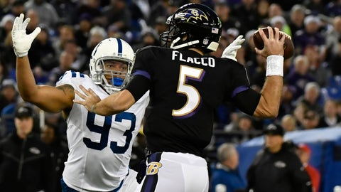 Dec 23, 2017; Baltimore, MD, USA; Indianapolis Colts linebacker Jabaal Sheard (93) applies pressure as Baltimore Ravens quarterback Joe Flacco (5) throws during the first quarter at M&T Bank Stadium. Mandatory Credit: Tommy Gilligan-USA TODAY Sports