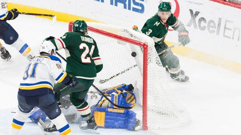 Dec 2, 2017; Saint Paul, MN, USA; Minnesota Wild defenseman Matt Dumba (24) scores the game winning goal in overtime against the St. Louis Blues at Xcel Energy Center. Minnesota won 2-1. Mandatory Credit: Harrison Barden-USA TODAY Sports