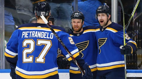 Dec 30, 2017; St. Louis, MO, USA; St. Louis Blues center Patrik Berglund (21) celebrates with center Kyle Brodziak (28) and defenseman Alex Pietrangelo (27) after scoring a goal against the Carolina Hurricanes during the second period at Scottrade Center. Mandatory Credit: Billy Hurst-USA TODAY Sports