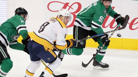 Nashville Predators center Kyle Turris (8) skates for the puck against Dallas Stars center Tyler Seguin (91) and center Devin Shore (17) during the second period of an NHL hockey game in Dallas, Saturday, Dec. 23, 2017. (AP Photo/LM Otero)