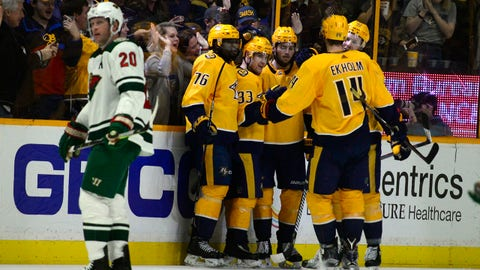 Nashville Predators forward Viktor Arvidsson (33) is congratulated after scoring against the Minnesota Wild in the third period of an NHL hockey game Saturday, Dec. 30, 2017, in Nashville, Tenn. (AP Photo/Mike Strasinger)
