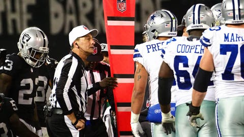 Dec 17, 2017; Oakland, CA, USA; The referees measure whether the Dallas Cowboys reached first down against the Oakland Raiders during the fourth quarter at Oakland Coliseum. Mandatory Credit: Kelley L Cox-USA TODAY Sports