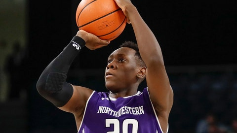 Dec 16, 2017; Chicago, IL, USA; Northwestern Wildcats guard Scottie Lindsey (20) shoots against the DePaul Blue Demons during the second half at Wintrust Arena. Mandatory Credit: Kamil Krzaczynski-USA TODAY Sports