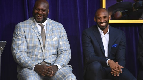 Mar 24, 2017; Los Angeles, CA, USA; Los Angeles Lakers former center Shaquille O'Neal (left) and guard Kobe Bryant react during ceremony to unveil statue of O'Neal at Staples Center. Mandatory Credit: Kirby Lee-USA TODAY Sports