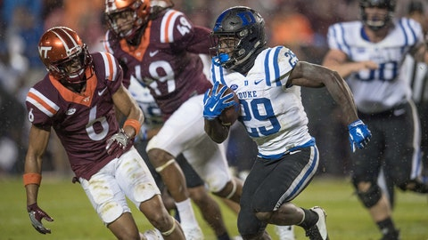 Oct 28, 2017; Blacksburg, VA, USA; Duke Blue Devils running back Shaun Wilson (29) runs the ball in the second period as Virginia Tech Hokies defensive back Mook reynolds chases play at Lane Stadium. Mandatory Credit: Lee Luther Jr.-USA TODAY Sports