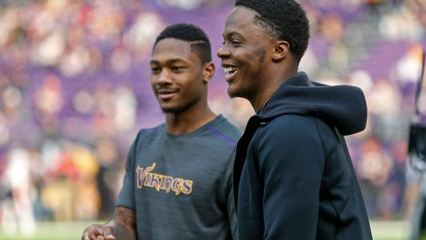 Jan 1, 2017; Minneapolis, MN, USA; Minnesota Vikings quarterback Teddy Bridgewater (5) (right) and wide receiver Stefon Diggs (14) smile along the sideline before the game against the Chicago Bears at U.S. Bank Stadium. Mandatory Credit: Bruce Kluckhohn-USA TODAY Sports
