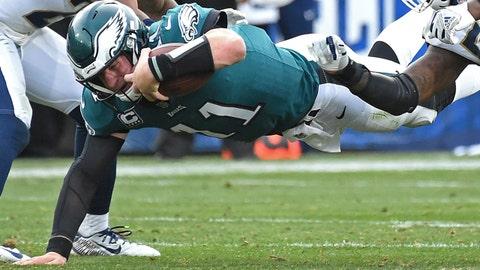 Dec 10, 2017; Los Angeles, CA, USA; Philadelphia Eagles quarterback Carson Wentz (11) is stopped by Los Angeles Rams inside linebacker Alec Ogletree (52) after a five yard gain in the third quarter of the game at the Los Angeles Memorial Coliseum. Mandatory Credit: Jayne Kamin-Oncea-USA TODAY Sports