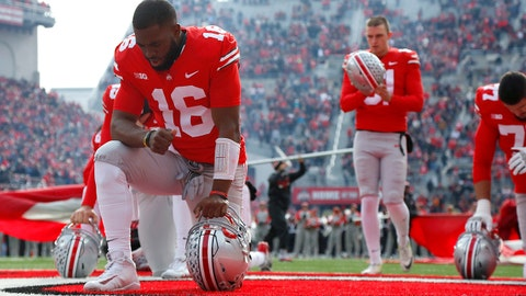 Nov 11, 2017; Columbus, OH, USA; Ohio State Buckeyes quarterback J.T. Barrett (16) kneels  before a game against the Michigan State Spartans at Ohio Stadium.  Mandatory Credit: Joe Maiorana-USA TODAY Sports