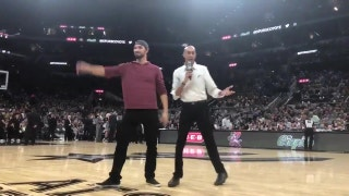 Texas Rangers pitcher Tony Barnette helps toss t-shirts at Spurs game