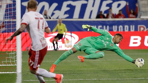 Columbus Crew goalkeeper Zack Steffen, right, deflects a shot by New York Red Bulls midfielder Daniel Royer, left, during the first half of an MLS soccer match, Saturday, April 22, 2017, in Harrison, N.J. (AP Photo/Julio Cortez)