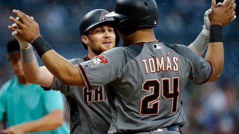 Arizona Diamondbacks' Yasmany Tomas, right, congratulates Brandon Drury at the plate for Drury's two-run home run against the San Diego Padres during the first inning of a baseball game in San Diego, Friday, May 19, 2017. (AP Photo/Alex Gallardo)