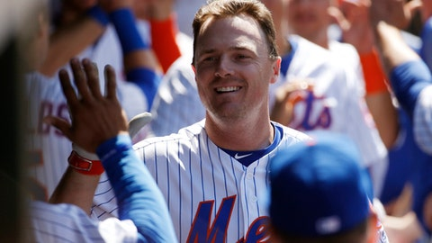 Teammates greet New York Mets Jay Bruce after he hit a sixth-inning, three-run, home run in an interleague baseball game against the Los Angeles Angels, Sunday, May 21, 2017, in New York. (AP Photo/Kathy Willens)