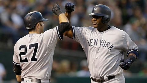 New York Yankees' Chris Carter, right, celebrates with Austin Romine (27) after hitting a home run off Oakland Athletics' Sean Manaea during the sixth inning of a baseball game Friday, June 16, 2017, in Oakland, Calif. (AP Photo/Ben Margot)