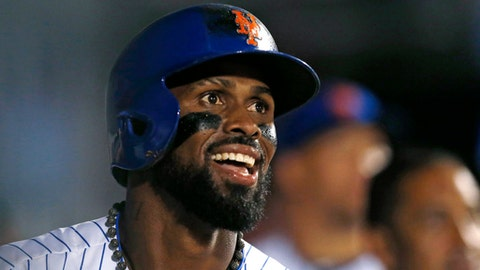 New York Mets shortstop Jose Reyes smiles as he watches a replay of his sixth-inning double on which he scored after the St. Louis Cardinals committed two errors on the play, during a baseball game, Monday, July 17, 2017, in New York. (AP Photo/Kathy Willens)