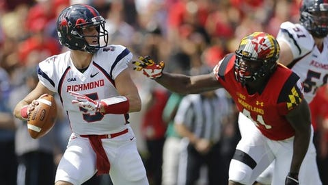 Richmond quarterback Kyle Lauletta, left, looks for a receiver as he is pressured by Maryland defensive lineman Jesse Aniebonam in the first half of an NCAA college football game, Saturday, Sept. 5, 2015, in College Park, Md. (AP Photo/Patrick Semansky)
