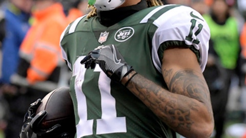 New York Jets wide receiver Robby Anderson (11) runs into the end zone while scoring on a pass from quarterback Josh McCown, not pictured, during the second half of an NFL football game against the Carolina Panthers, Sunday, Nov. 26, 2017, in East Rutherford, N.J. (AP Photo/Bill Kostroun)