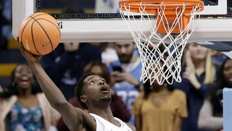 North Carolina's Jalek Felton drives for a basket against Western Carolina during the second half of an NCAA college basketball game in Chapel Hill, N.C., Wednesday, Dec. 6, 2017. North Carolina won 104-61. (AP Photo/Gerry Broome)