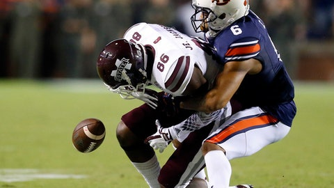File-This Sept. 30, 2017, file photo shows Auburn defensive back Carlton Davis (6) breaking up a pass intended for Mississippi State wide receiver Jesse Jackson (86) during the second half of an NCAA college football game, in Auburn, Ala. Davis was selected to the AP All-America team announced Monday, Dec. 11, 2017. (AP Photo/Butch Dill, File)
