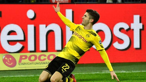 Dortmund's Christian Pulisic celebrates after he scored his side's second goal during the German Bundesliga soccer match between Borussia Dortmund and TSG Hoffenheim in Dortmund, Germany, Saturday, Dec. 16, 2017. Dortmund defeated Hoffenheim with 2-1. (AP Photo/Martin Meissner)