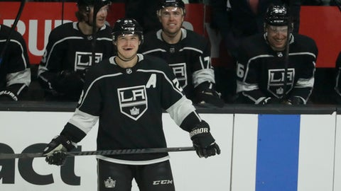 Los Angeles Kings right wing Dustin Brown smiles while being honored for his 1,000th NHL hockey game, all with the Kings, during the first period against the Colorado Avalanche in Los Angeles, Thursday, Dec. 21, 2017. (AP Photo/Chris Carlson)