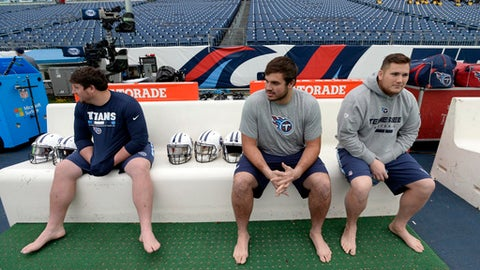 Tennessee Titans center Ben Jones, left, offensive tackle Jack Conklin, center, and offensive lineman Brian Schwenke sit on a heated bench before an NFL football game against the Los Angeles Rams Sunday, Dec. 24, 2017, in Nashville, Tenn. (AP Photo/Mark Zaleski)