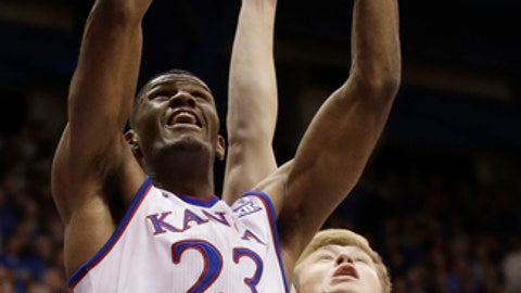 File-This Nov. 7, 2017, file photo shows Kansas' Billy Preston (23) getting past Fort Hays State's Jared Vitztum for a shot during the first half of an NCAA college exhibition basketball game in Lawrence, Kan. The fact that the gap has narrowed between Kansas and its rivals has every bit as much to do with the Jayhawks, though. Their reliance on outside shooting. Their ability to get to the foul line. Their perilous lack of depth, which has been somewhat alleviated now that Sun Devils transfer Sam Cunliffe is eligible and five-star prospect Silvio De Sousa has arrived on campus for the second semester. If they can get their other five-star recruit, Preston, on the court after spending the entire fall investigating an off-the-court financial issue, the Jayhawks could still be the team to beat. (AP Photo/Charlie Riedel, File)