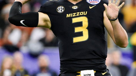 Missouri quarterback Drew Lock throws a pass during the first half of the Texas Bowl NCAA college football game against Texas, Wednesday, Dec. 27, 2017, in Houston. (AP Photo/Eric Christian Smith)